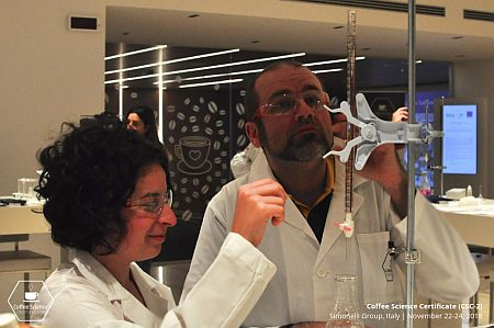 Paolo Scimone and Helena working in the lab